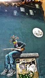 building end street art, Bill has mask and headdress envy.