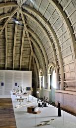 """interior of Colegio Benigno Malo building with Bienal artists Pedro Neves Marquez' """"Monsanto (The enlightened evolution of the Genome) and Manuela Ribandeneia's """"El Arte de Navegar""""."""