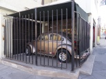 on one of our walks we found this caged VW bug